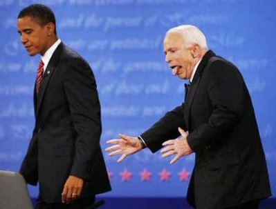 As they exit the stage, John McCain is seen here fighting the urge to give Obama a wedgie.